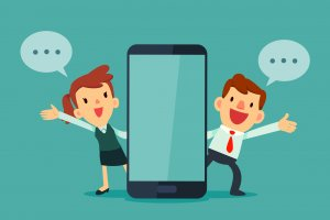 businessman and businesswomen talking beside smart phone with blank screen